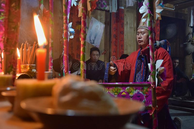 GUIZHOU PROVINCE, CHINA – CIRCA DECEMBER 2018: The ritual redeeming the vow. The ritual redeeming the vow`in a village of Guizhou accompanied by royalty free stock image