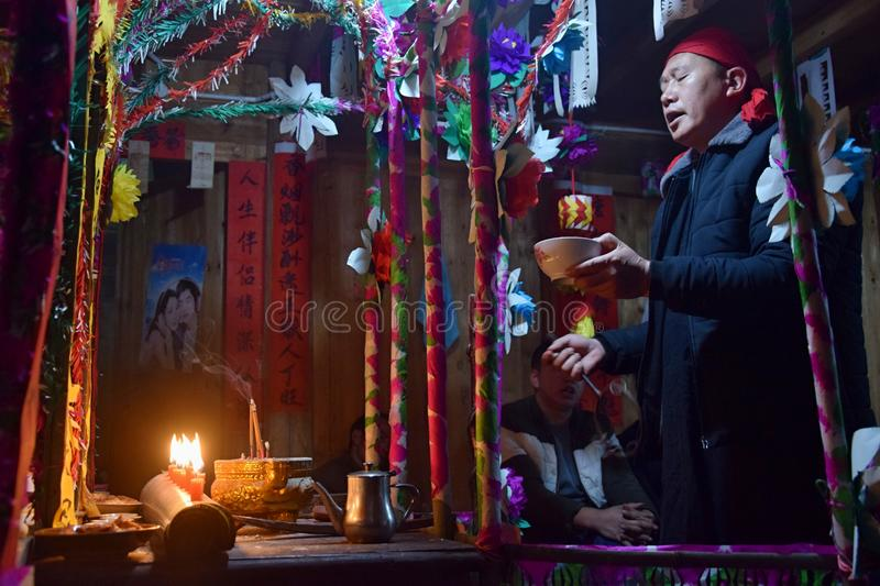 GUIZHOU PROVINCE, CHINA – CIRCA DECEMBER 2018: The ritual redeeming the vow. The ritual redeeming the vow`in a village of Guizhou accompanied by stock photos