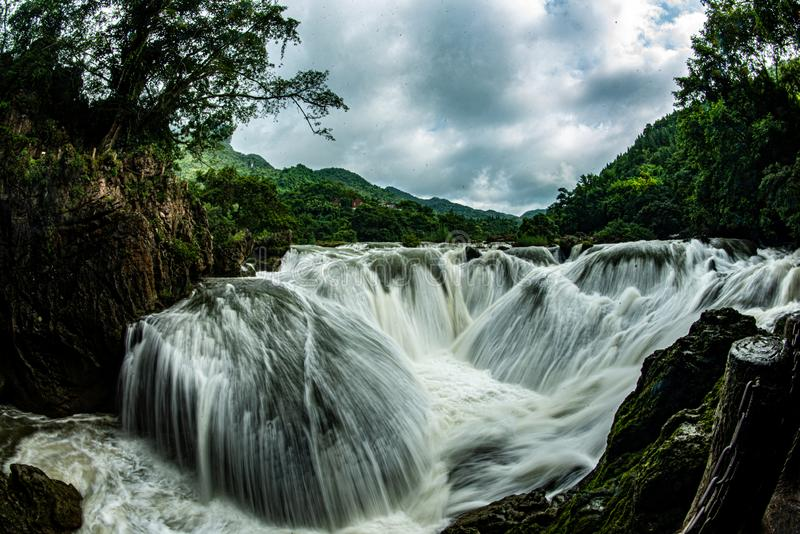 It's like putting silver in the pool. Guizhou Tianxingqiao Scenic Area, due to the relationship between karst landforms, formed a waterfall with a large royalty free stock photography