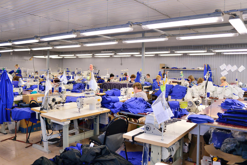 GUKOVO, RUSSIA - SEPTEMBER, 2016: Workers work in a garment royalty free stock photo