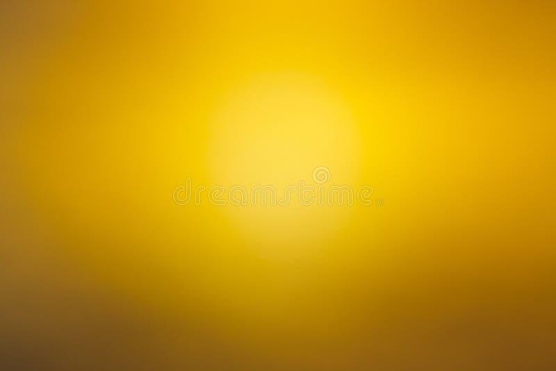 Gul abstrakt suddig bakgrund