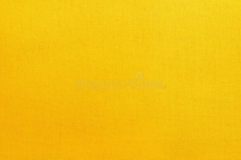 Gul bakgrund f?r textur f?r bomullstyg, s?ml?s modell av den naturliga textilen royaltyfria bilder