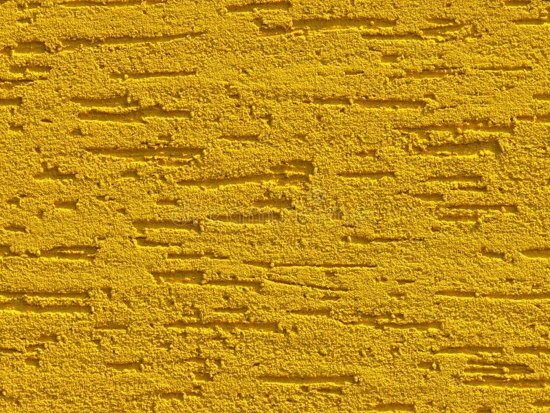 Gul bakgrundsfasad gips Dekorativ bakgrund för monolitiskt gips Papper med enkelt lager, skrapat av cementplast Sand-text fotografering för bildbyråer