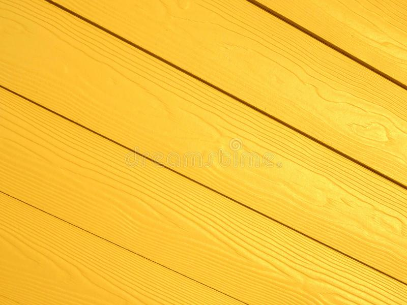 Gul diagonal Wood modellbakgrund arkivfoto