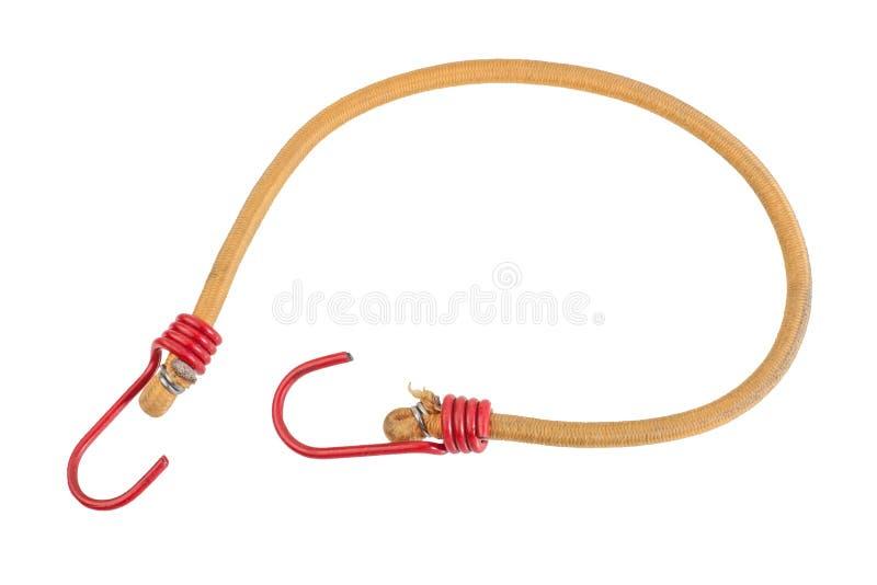Gul elastisk rem med röda krokar som isoleras på vit bakgrund Bungeekabel, töjbart rep för flätat nylon royaltyfria foton