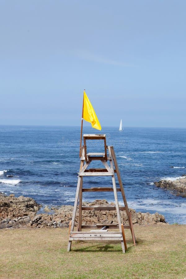 Gul flagga, varning fotografering för bildbyråer