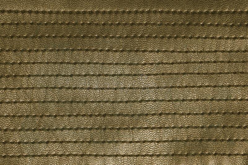 Gul grunge sydd läderbakgrund arkivfoto