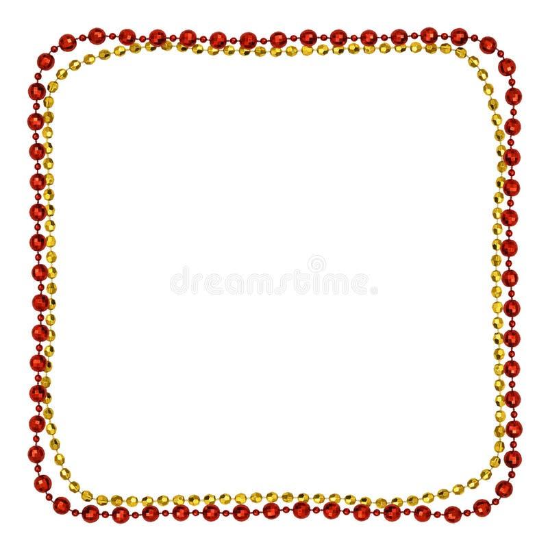 Gul jul och röda girlander med runda pärlor i en fyrkantig ram fotografering för bildbyråer