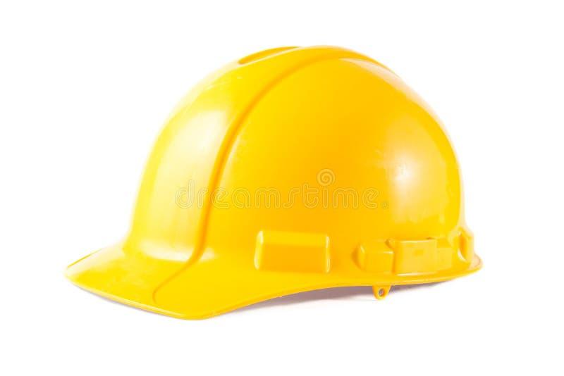 Gul konstruktionshatt som isoleras på vit arkivbild