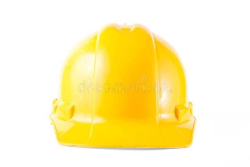 Gul konstruktionshatt som isoleras på vit royaltyfria foton
