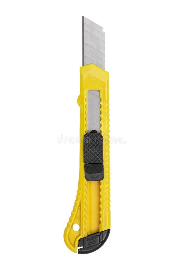 Gul kontorskniv som isoleras på vit bakgrund Den gula brevpapperkniven som isoleras p? vit bakgrund fotografering för bildbyråer