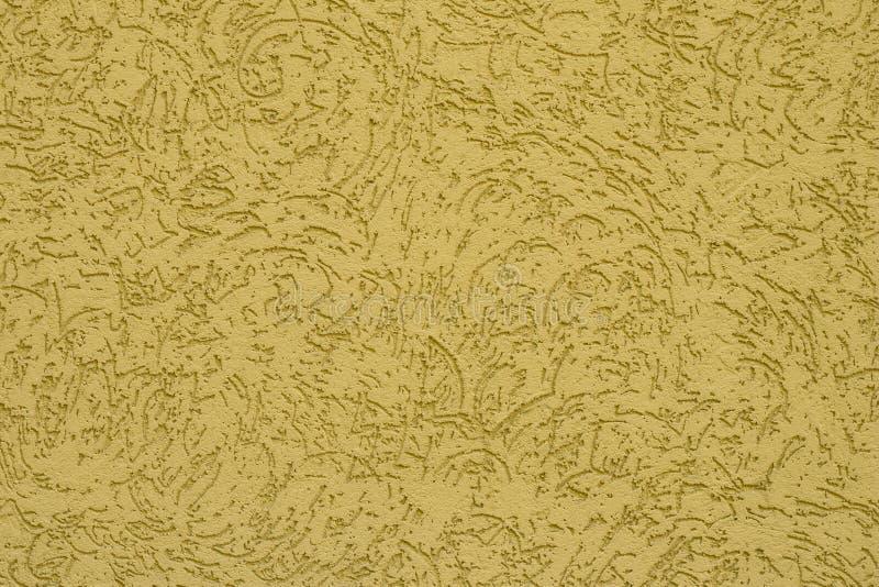 Gul pappers- texturtappningbakgrund Abstrakt modell på den varma gula väggen Den ribbade gula yttersidan av betongväggen Gult b royaltyfri foto