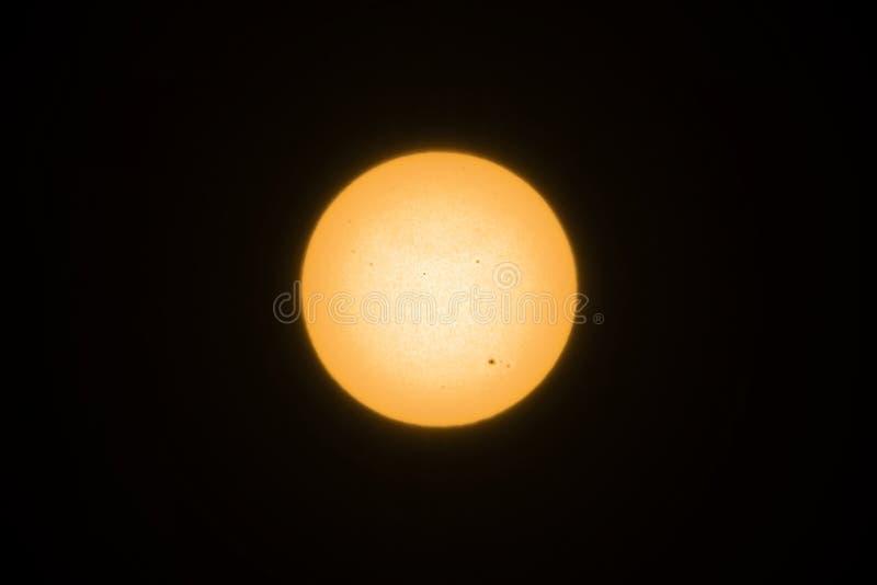 Gul sol med solfläckar royaltyfri foto