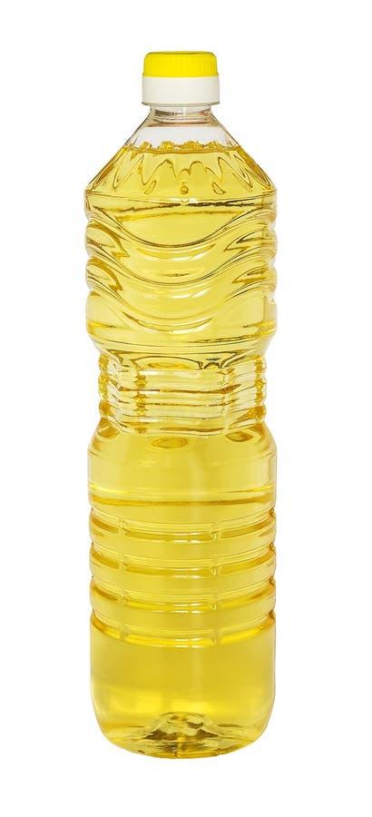 Gul solros- eller grönsakolja i en plast- literflaska som isoleras på vit bakgrund, closeup arkivfoton