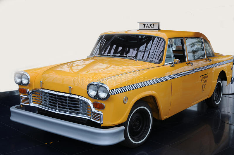 Gul taxitaxi fotografering för bildbyråer