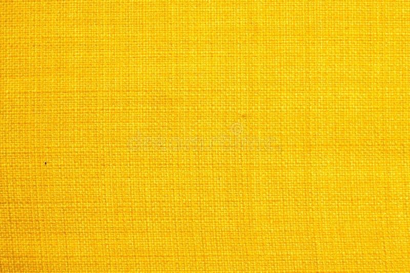 Gul tygtextur bakgrundstexturfärg royaltyfri fotografi