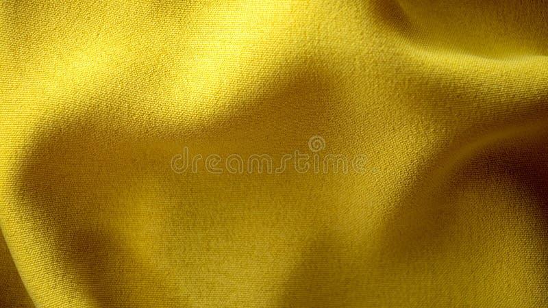 Gul tygtextur f?r bakgrund arkivbild