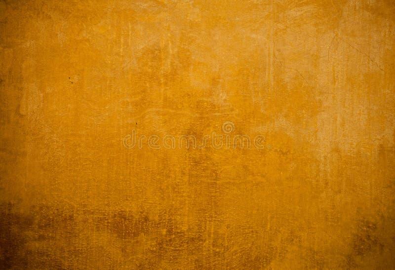 Gul väggbakgrund arkivfoton