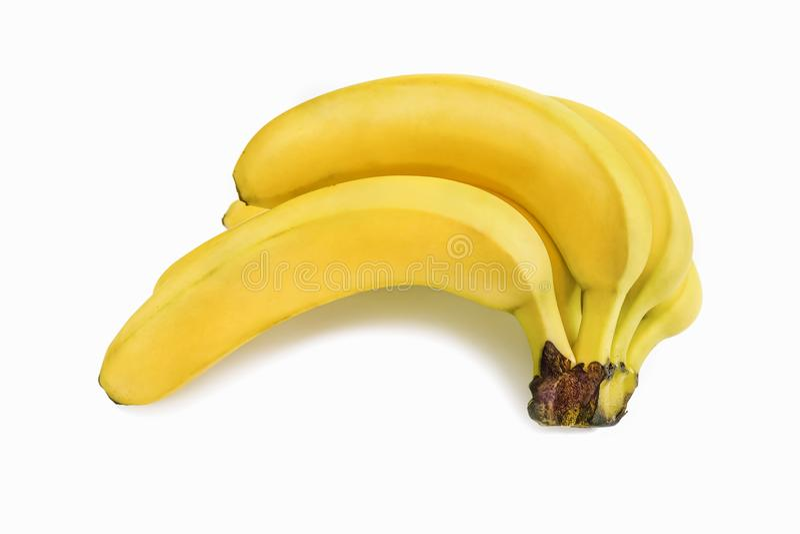 Gula bananer som ligger på dess sida på en vit bakgrund med en skugga arkivfoto