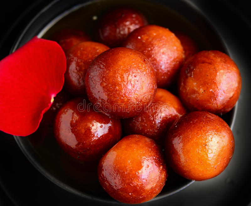 Gulab Jamun. Is a traditional Indian dessert.This sweet is made out of milk powder and fried like donut.Later dipped in thick sugar syrup royalty free stock image