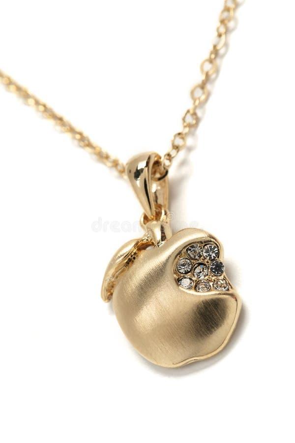 Guld- äpple för hänge royaltyfria foton