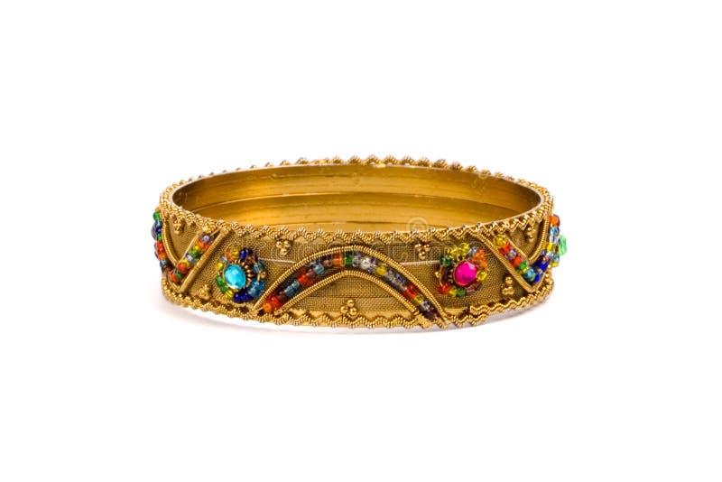 guld- armband royaltyfri fotografi