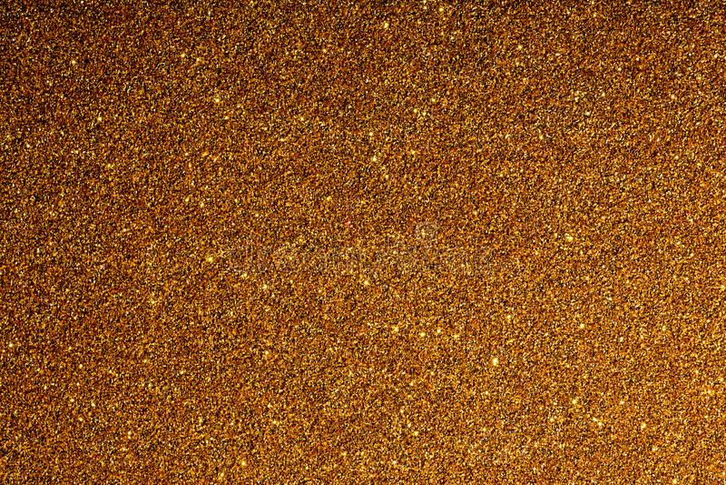 Guld- bakgrund med mousserar textur av stor upplösning arkivfoto