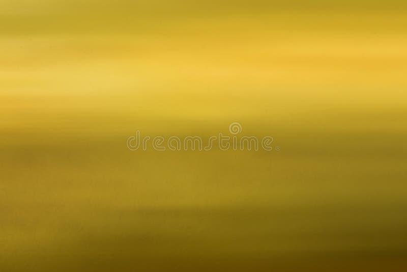 Guld- bakgrund texturerar royaltyfria foton