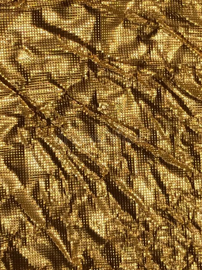 Guld- bakgrundsmetalltextur arkivfoto