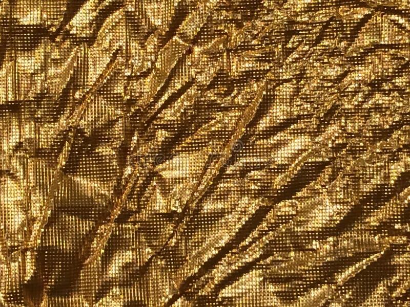 Guld- bakgrundsmetalltextur royaltyfri fotografi