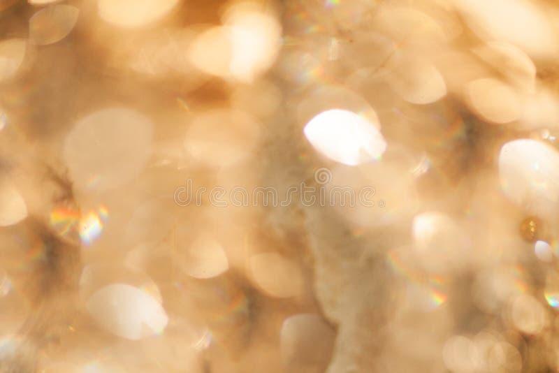 Guld- bakgrundstextur för abstrakt bokeh royaltyfri bild