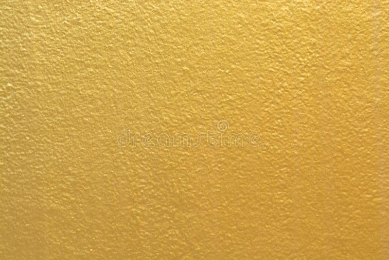 Guld- bakgrundstexturlyx arkivfoton