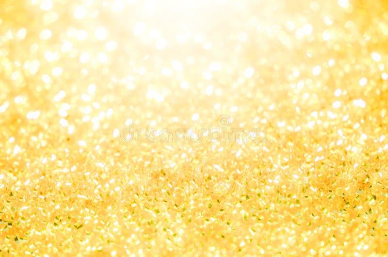 Guld- belysning för abstrakt bokeh arkivbilder