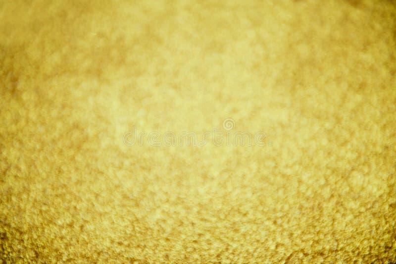 Guld- bokehabstrakt begreppbakgrund arkivfoto