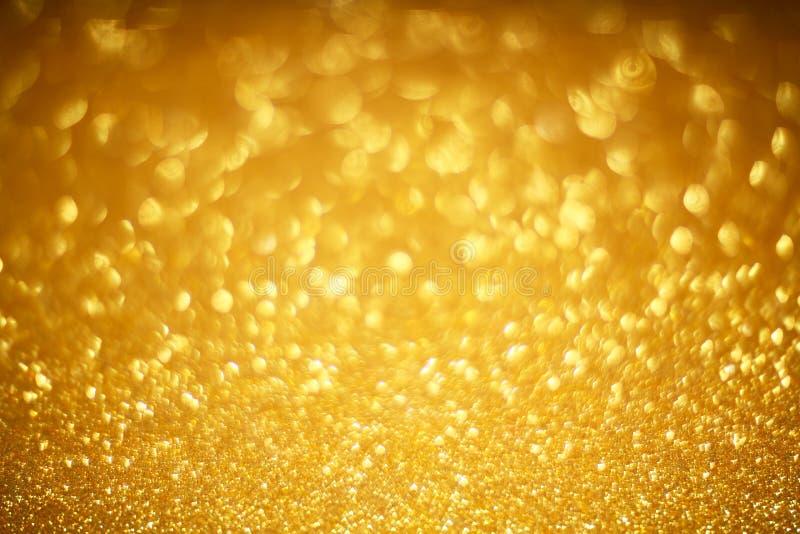Guld- bokehbakgrund royaltyfri foto
