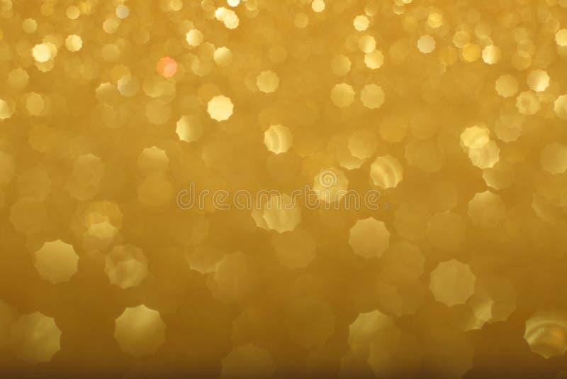 Guld- bokehbakgrund arkivfoton