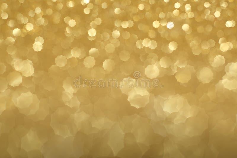 Guld- bokehbakgrund royaltyfri fotografi