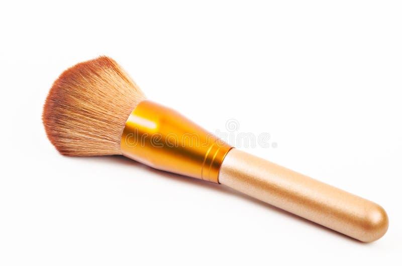 Guld- borstepulver för makeup royaltyfria bilder