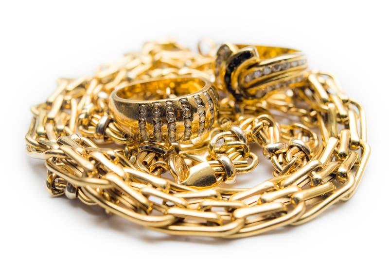 Guld- cirklar och kedjor arkivfoton