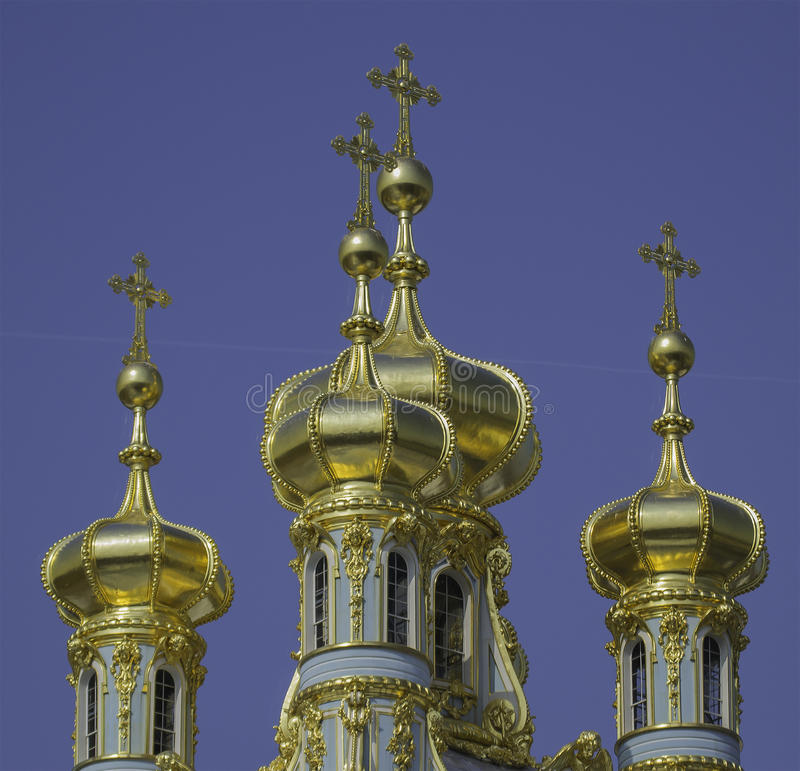 guld- cupolas royaltyfria bilder