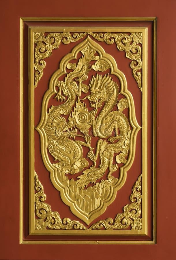 Guld- Dragon Wood Carved arkivbilder