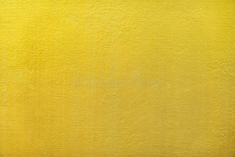 Guld- eller folieväggmålarfärg för den abstrakta bakgrunden och texturen royaltyfri bild