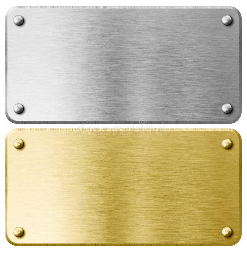 Guld- eller mässingsmetallplatta med isolerade nitar fotografering för bildbyråer