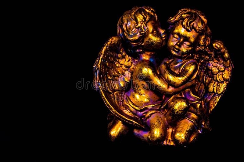Guld- färgrika änglar arkivfoto