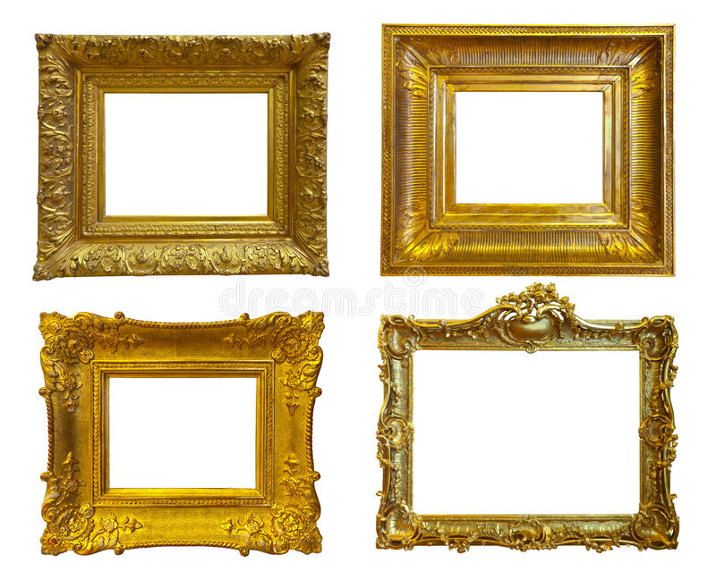 Guld- föreställa inramar. Isolerat över vit arkivfoto