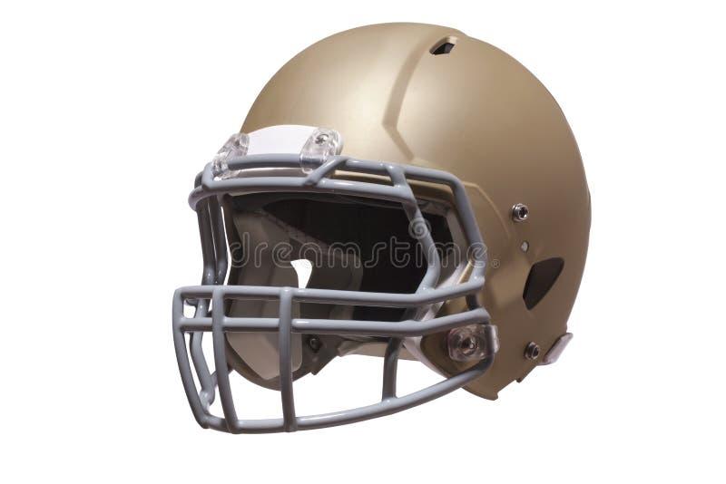 Guld- fotbollhjälm som isoleras på whtie arkivfoton