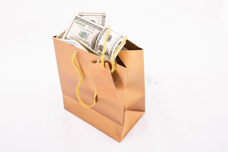 Guld- gåvapåse med dollar royaltyfri foto