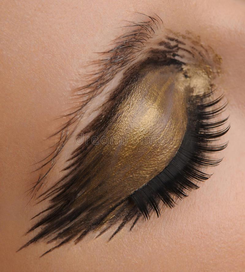 Guld- glamourögonsmink arkivbild