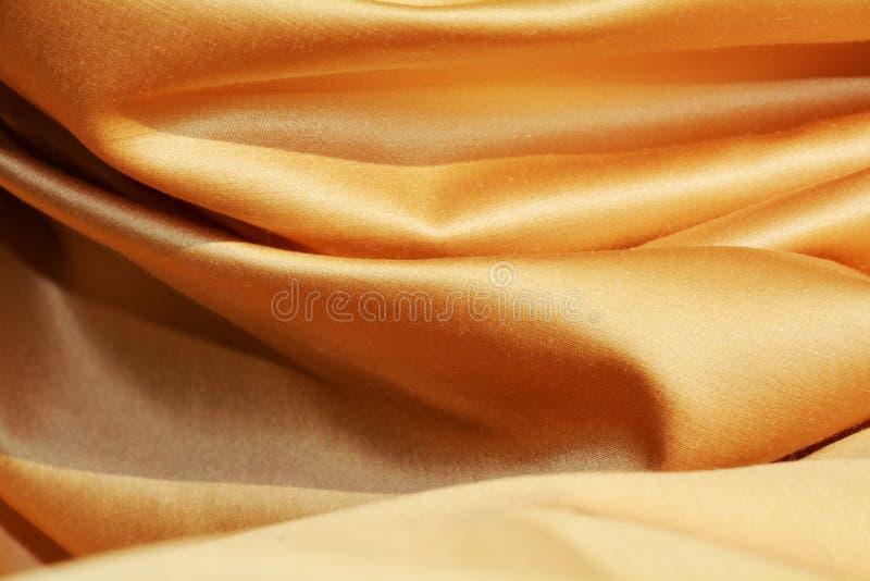 Guld- härliga veck, bakgrund royaltyfri bild