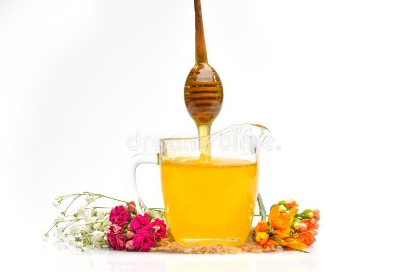 Guld- honung i exponeringsglaset arkivbilder